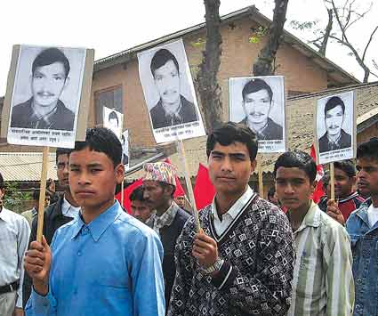 Students in Dang hold placards in a rally depicting photos of Umesh Thapa who was killed by security force in the Feb 8 municipal day in Dang.