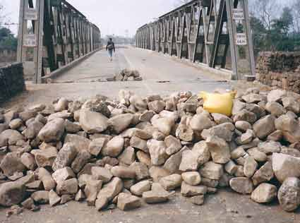 Maoists put stones and logs on Daldale Bridge at Butwal-Narayanghat section of Mahendra Highway.