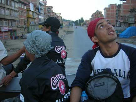 Suraj Kunwar at the top of a bus heading to Kunta Beshi. Gazing at the sky.