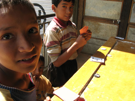 Boys play cards and carom board in Talamarang