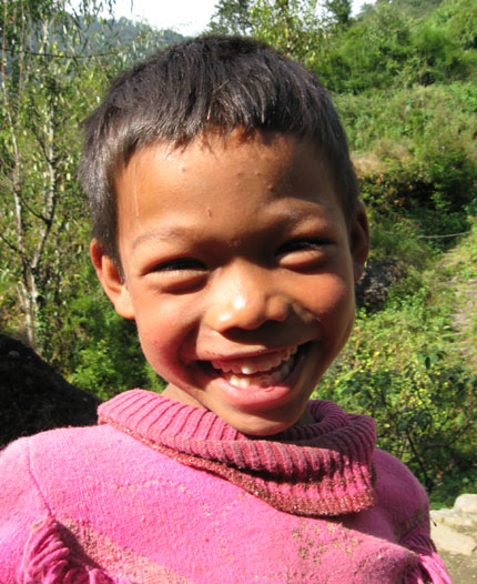 A boy at Melamchi Khola and a hole on his trouser