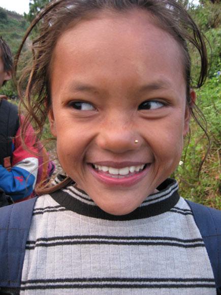 A girl smiles