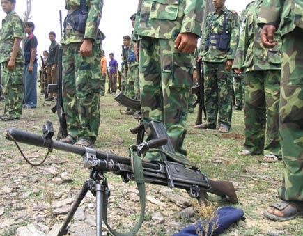 A gun in front of many maoist guerilla