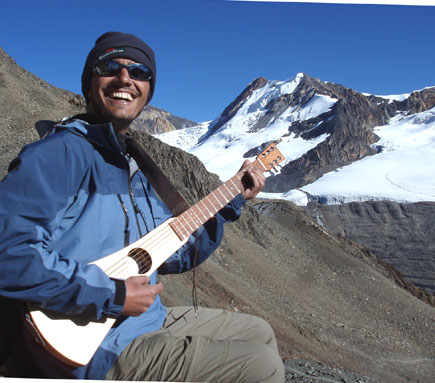 dinesh wagle on kang la pass playing guitar