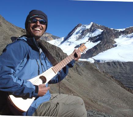 dinesh wagle on kang la pass playing guitar