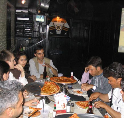 journalists eating pizza in washington d.c.