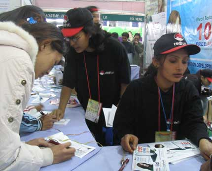 girls at can info tech stall