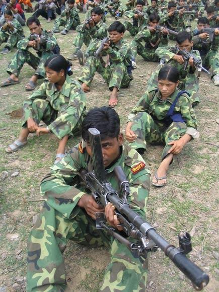 Maoist guerilla pointing guns
