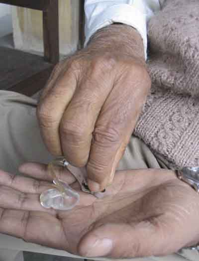 Hutaram Baidya and his hearing aid device