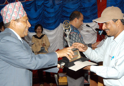 J Pandey, a Nepaljung-based reporter, receiving the award from Chairman Hem Raj Gyawali