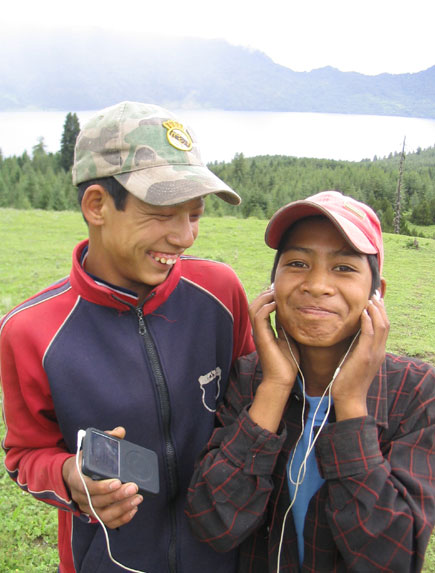 Two boys in Jumla, a remote district in Nepal, listen to folk songs iPod