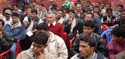 Editor Narayan Wagle, in red sweater, sorrounded by reporters of Kantipur Publications