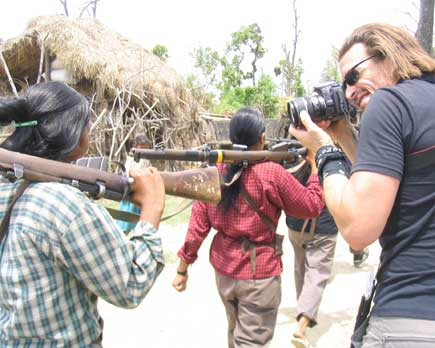 Kevin Sites in Kailali shooting a Maoist guerilla girl