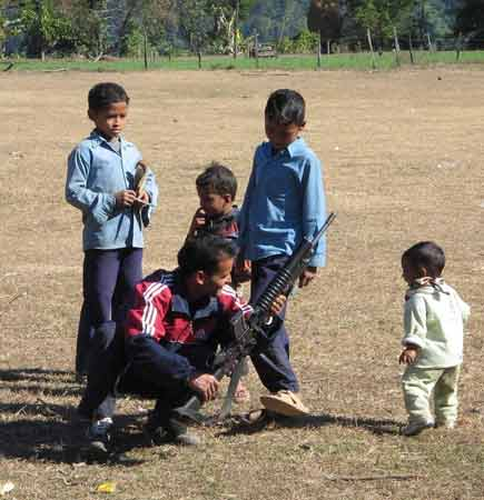 Maoist guerilla playing with gun and child