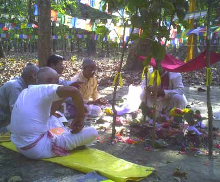 Performing Pooja in the meditating are praying for Little Buddha's safe and sound return