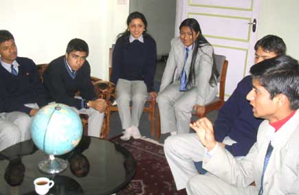 Krishna Pokharel of Noble Academy. His friends listen to him as he makes point