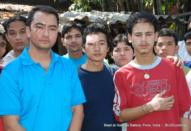 injured nepalis at german bakery, pune, india