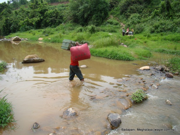 a gorkha carries his neighbor's belongings to safety in badapani