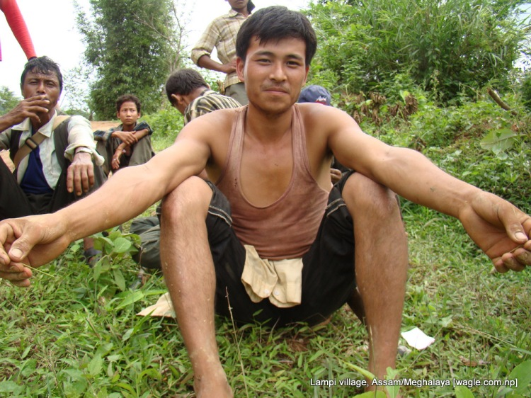 A Gorkha of Lampi at a construction site on the road that connects his village to Guwahati, Assam