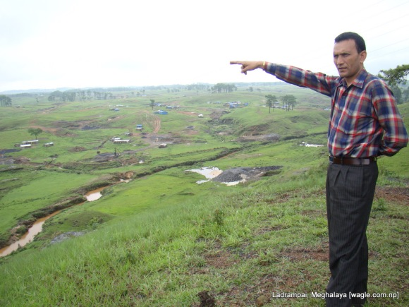 Ramesh Deuja, a sardar at one of the coal mines in Ladrampai in Meghalaya, points out towards the shacks where Nepali labourers stay.