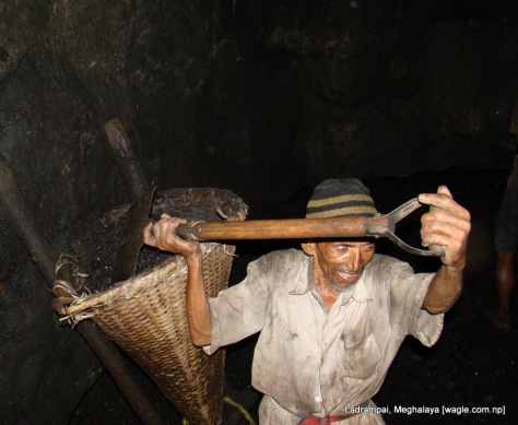 Ladrampai, Meghalaya mine labourer from nepal Shaym Prasad Pokharel fills up the basket with coal