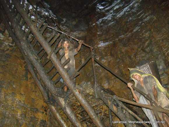 Ladrampai, Meghalaya coal mine labourers climbing a ladder
