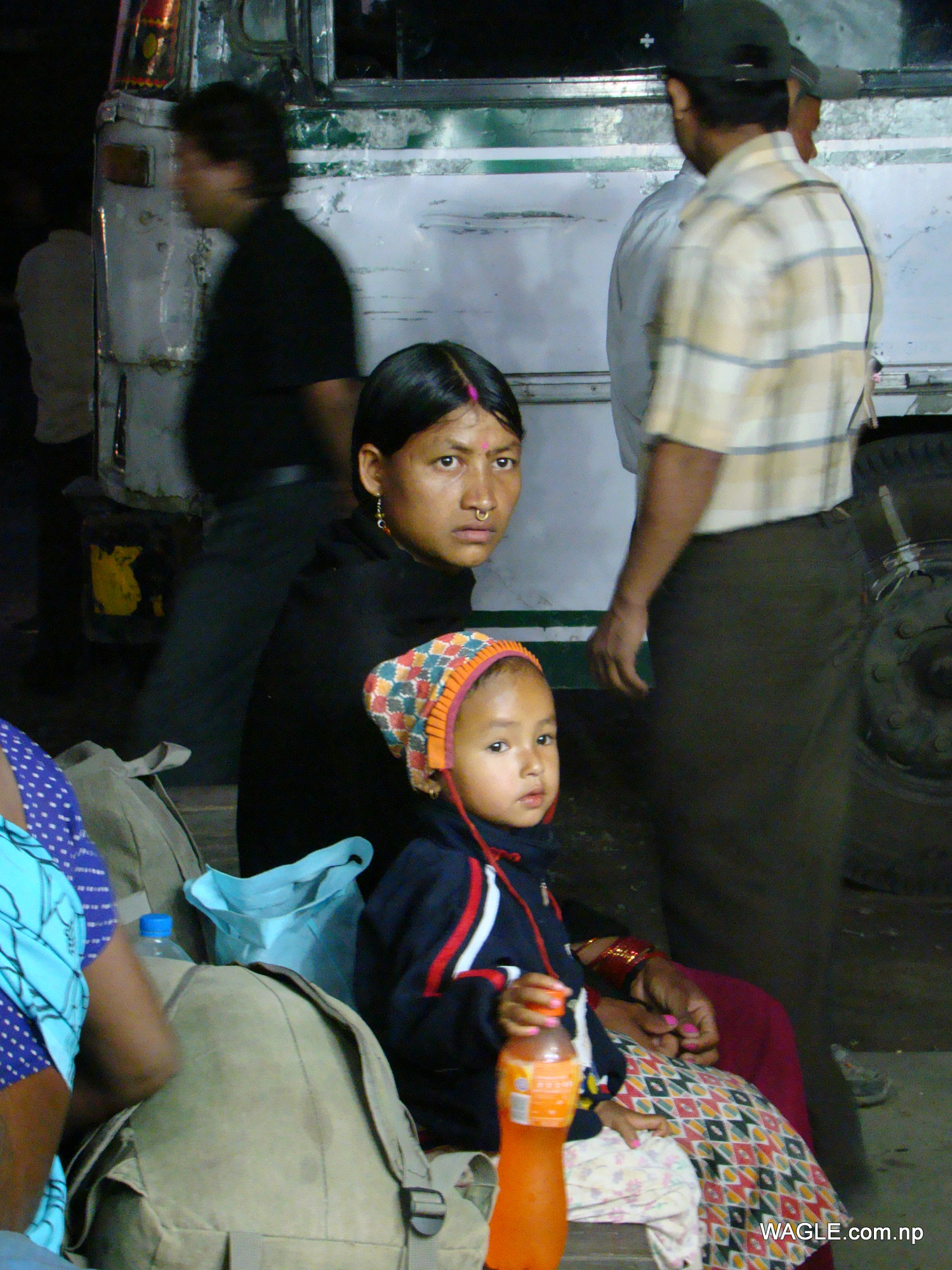 A kid and his mother: India bound- expecting to earn living that Nepal, their country, couldn't provide. At the bus stand in Banbasa, Indian town bordering far west Nepal