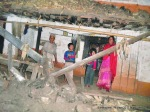 A family in Taplejung- shaken by the earthquake that damaged their home