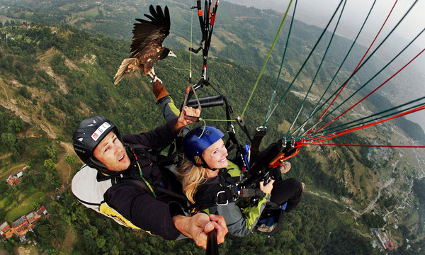 In Nepal, Gliding With a Feathered Guide
