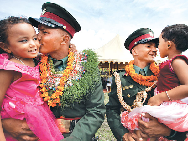 Seventy former Maoist combatants (two of them pictured) formally entered the Nepal Army as officers on Monday (26 Aug). Former People's Liberation Army combatants' integration into the national army was a key component of the peace process that began in 2006.