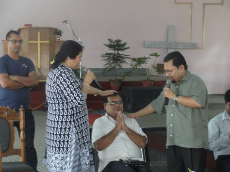Krishna Bahadur Mahara receives much needed blessings from a pastor KB Basel of the Gospal Assembly Church in Nepalgunj on 27th July.