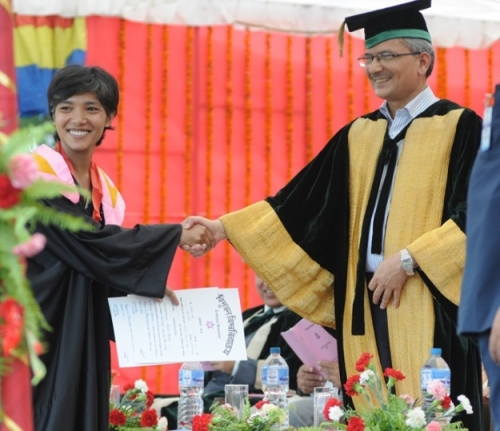 In this photo taken on Sunday, 8 July 2012, the then Prime Minister Baburam Bhattarai, in his capacity as the Chancellor of Tribhuvan University, is seen shaking hand with his daughter Manushi during the convocation ceremony held at the University campus in Kirtipur. Photo by Dinesh Shrestha via Nepalnews